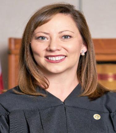 The Hon. Beth Watkins